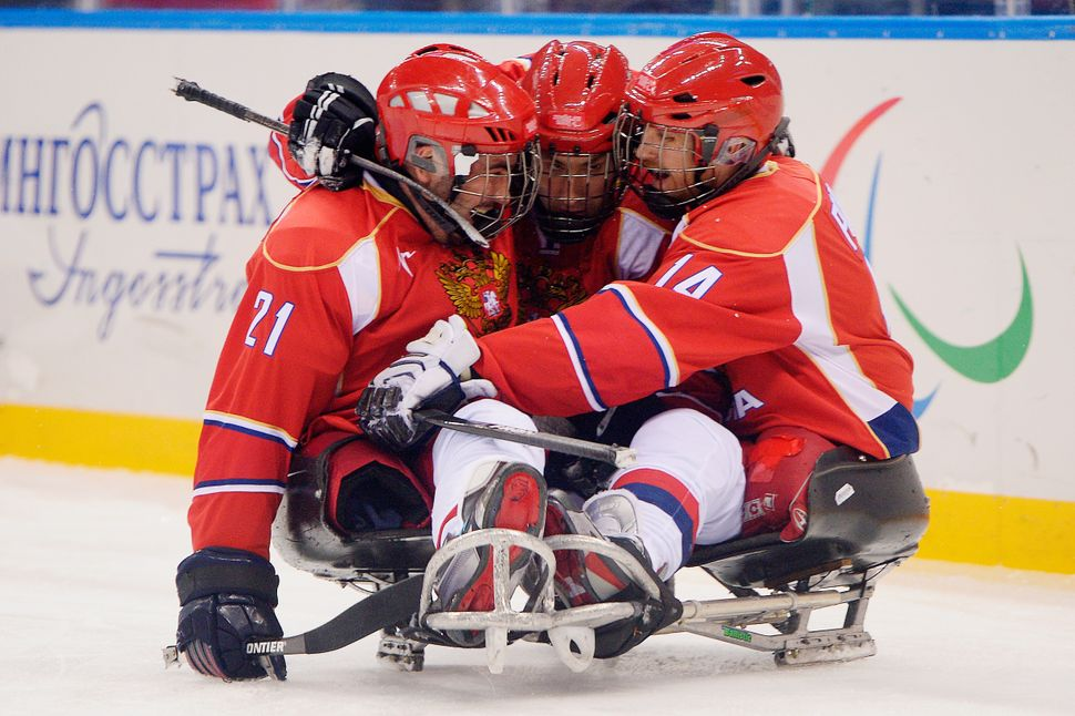 Andrey Dvinyaninov of Russia celebrates with teammates after scoring a goal in Sochi in 2014.