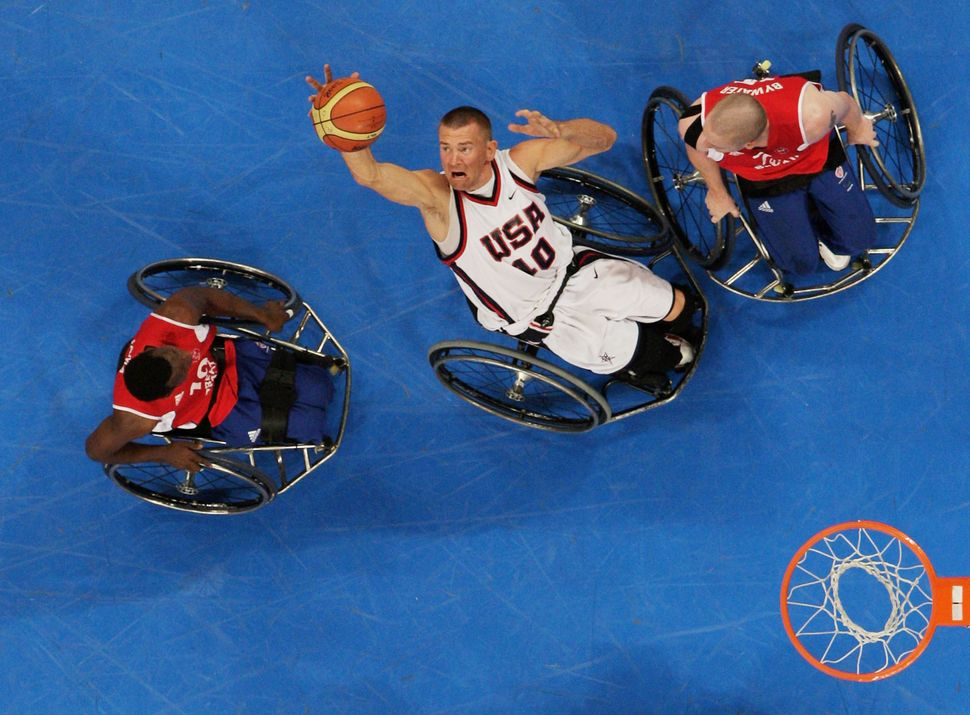 Jeff Glasbrenner rebounds during the wheelchair basketball match between the United States and Great Britain in 2008.