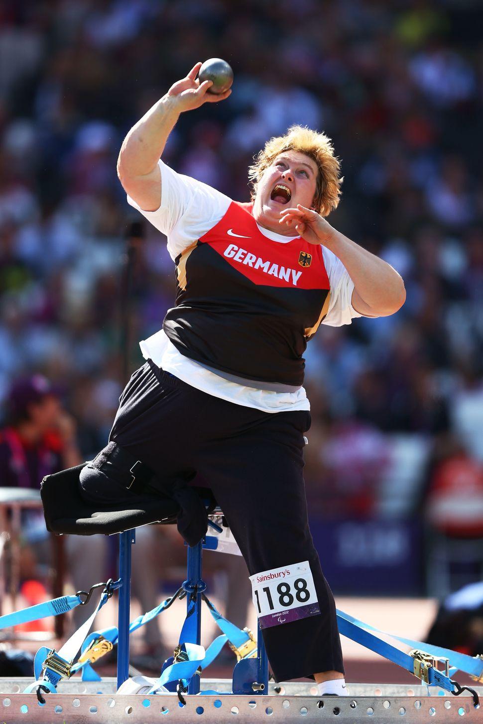 Germany's Ilke Wyludda competes in women's shot put inLondon.