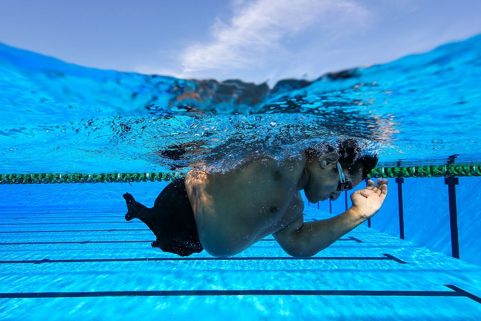 Argentina's Maximiliano Matto trains in the warm-up pool during the Paralympic swimming tournament in Rio.