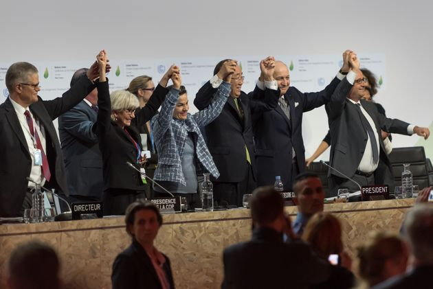 World leaders celebrate after the adoption of a historic global warming pact at the COP21 Climate Conference...