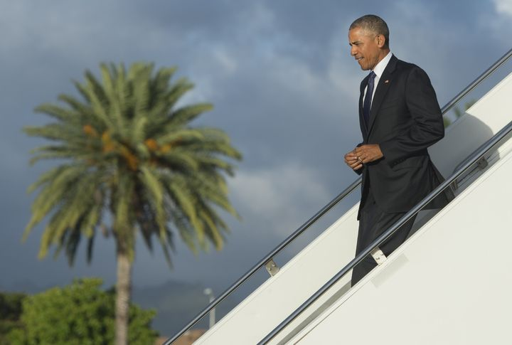 President Barack Obama disembarks from Air Force One in Honolulu, Hawaii, on Wednesday. He'll head to the remote Midway Atoll