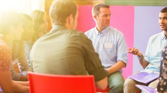 Man speaking in group therapy session