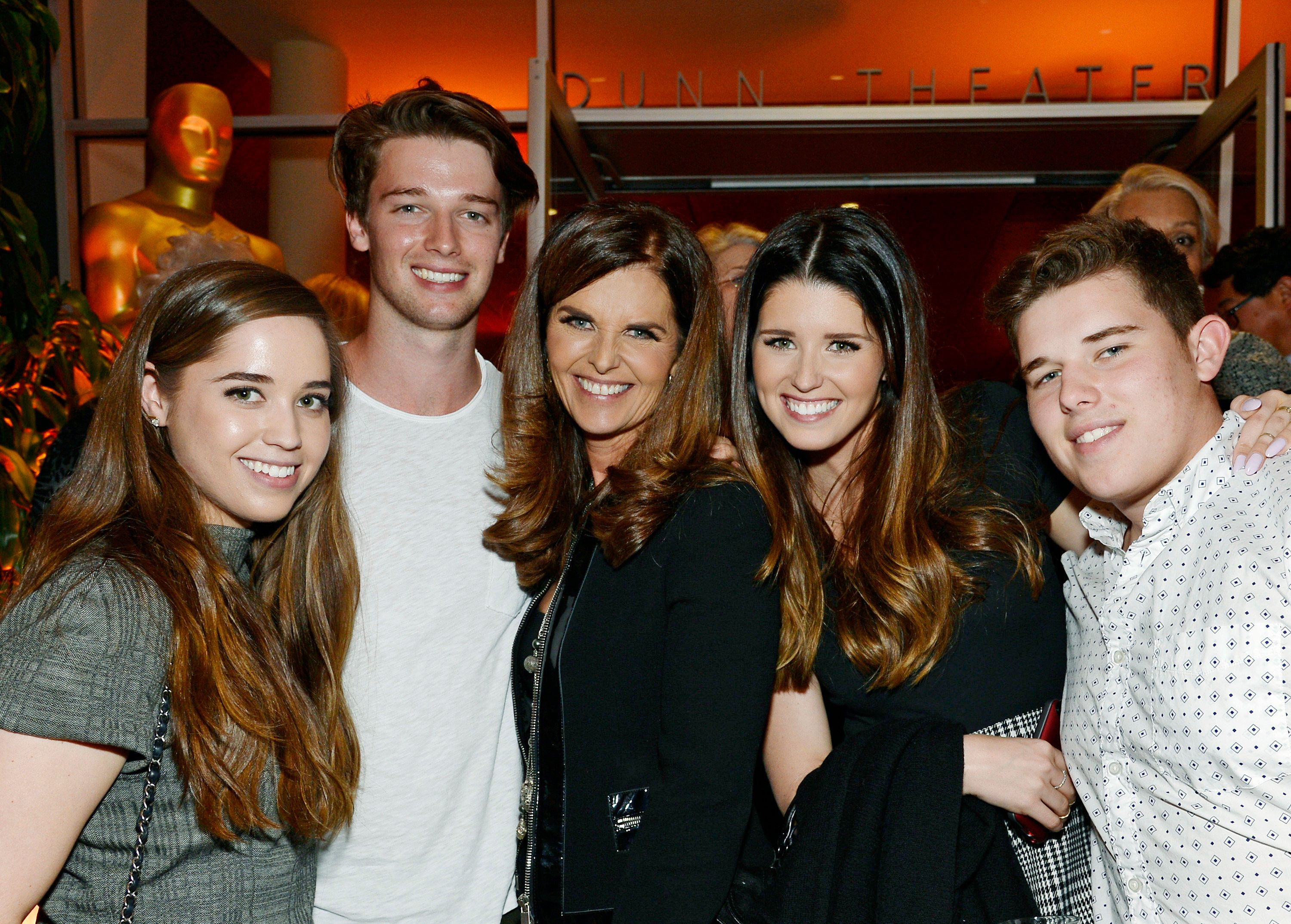 HOLLYWOOD, CA - MARCH 10: Executive producer Maria Shriver (C) is flanked by her children from left, Christina Schwarzenegger; Patrick Schwarzenegger; Katherine Schwarzenegger and Christopher Schwarzenegger at the reception after the premiere of HBO Documentary Films' 'Paycheck To Paycheck' at Linwood Dunn Theater at the Pickford Center for Motion Study March 10, 2014, in Hollywood, California.  (Photo by Kevork Djansezian/Getty Images)