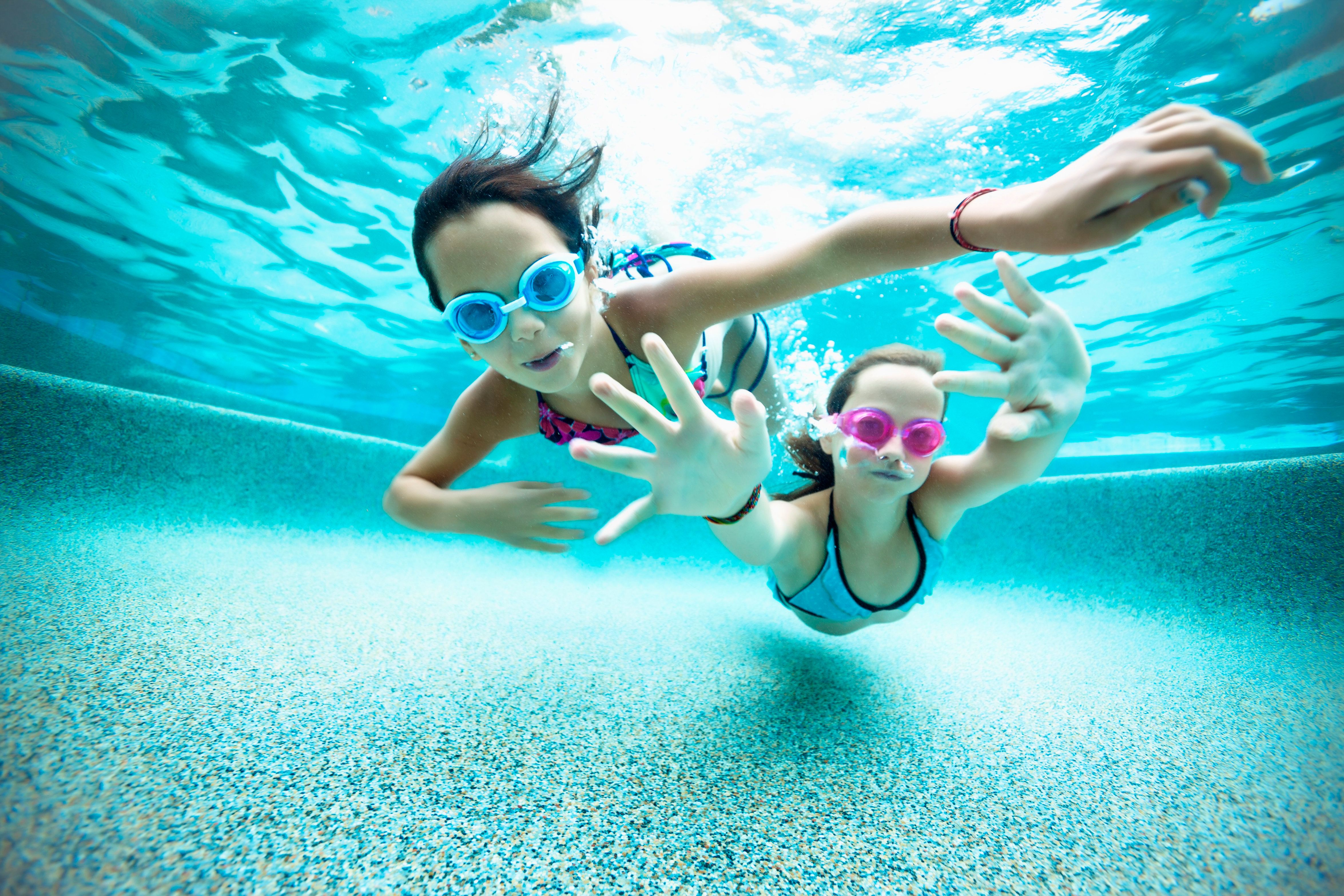 Two young girls underwater