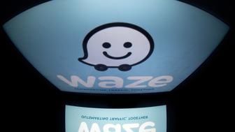 The logo of mobile app 'Waze' is displayed on a tablet on January 2, 2014 in Paris. Waze is a community-based traffic and navigation app.  AFP PHOTO / LIONEL BONAVENTURE        (Photo credit should read LIONEL BONAVENTURE/AFP/Getty Images)
