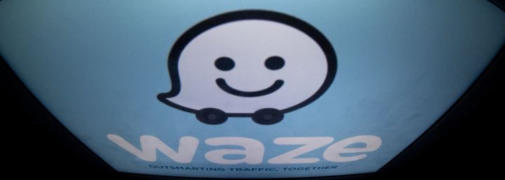 The Waze logo is displayed on a tablet, Jan. 2, 2014. The Alphabet-owned mobile app edged into Uber's territory this week.