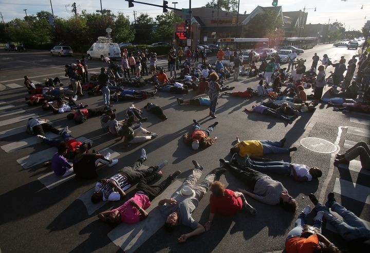 Demonstrators stage a sit-in as they protest the recent uptick in homicides across the city on Aug. 31 in Chicago. Chica