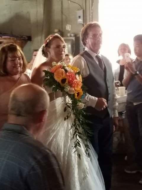 Nicole walking down the aisle toward Chris.