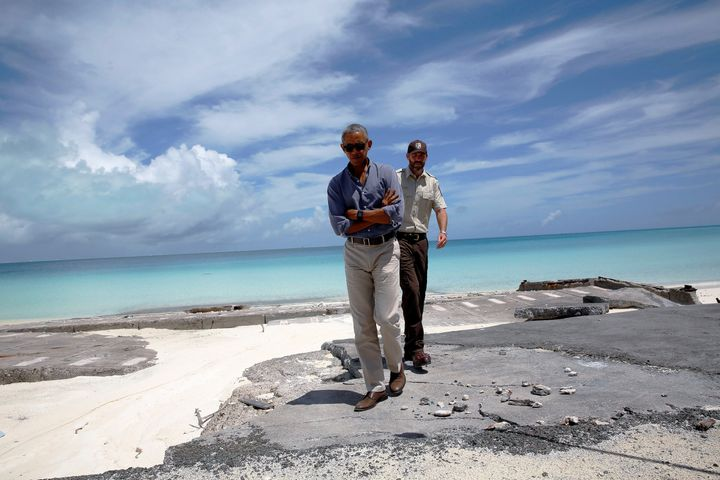Marine National Monuments Superintendent Matt Brown, right, gives President Barack Obama at tour of Turtle Beach at the Papah