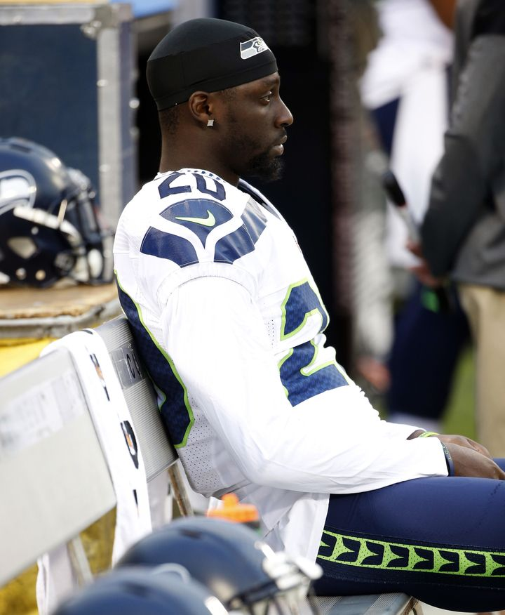 Jeremy Lane of the Seattle Seahawks sits as the national anthem plays during a preseason game in Oakland.