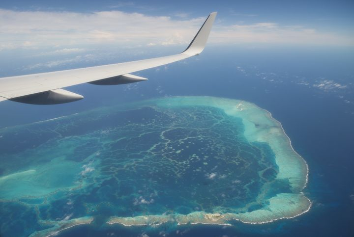 The view out the window of Air Force One, with President Barack Obama aboard, over a nearby island as the airplane approaches