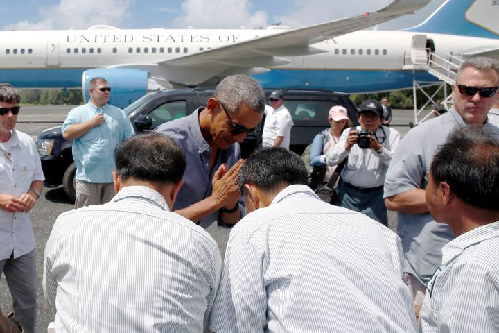President Barack Obama greets workers after landing aboard Air Force One at Henderson Field to visit the Papahanaumokuakea Ma