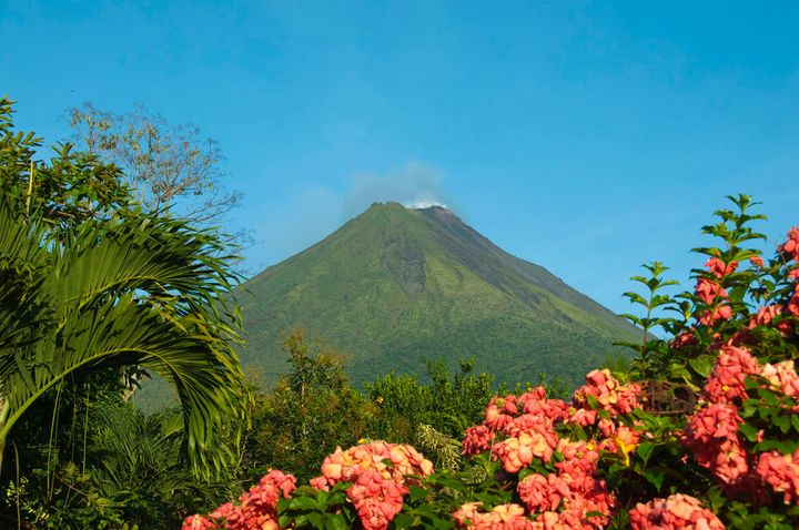 Wait for a cloud-free day to photograph the Arenal volcano's perfectly triangular apex.
