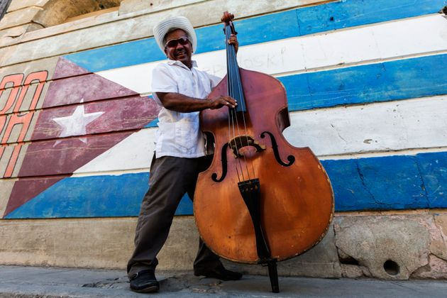 Traditional Cuban musician is played for tourists on the streets of Santiago de