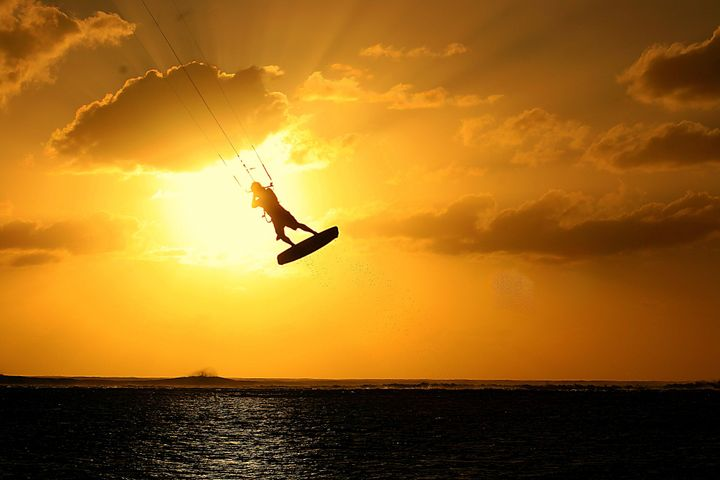 If you've ever wanted to try kitesurfing, Mauritius is a great place to learn.