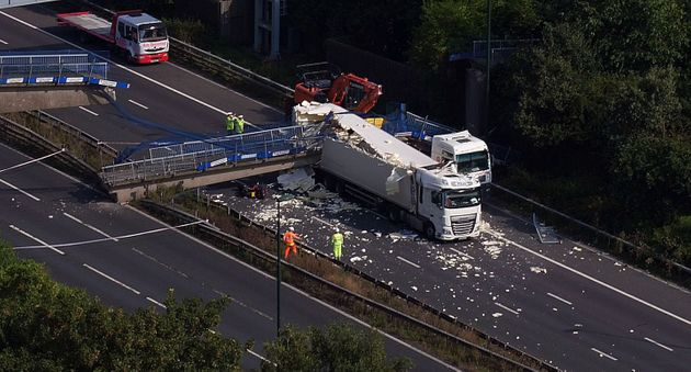 The scene on the M20 after a lorry hit a motorway footbridge, causing it to collapse last Bank Holiday