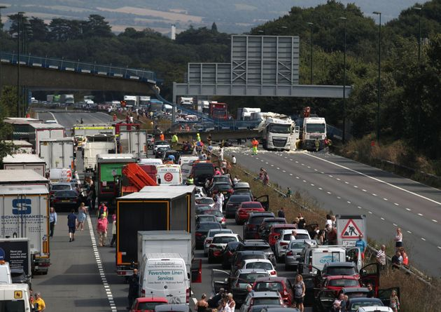The scene on the M20 motorway after a lorry hit a motorway bridge, causing it to