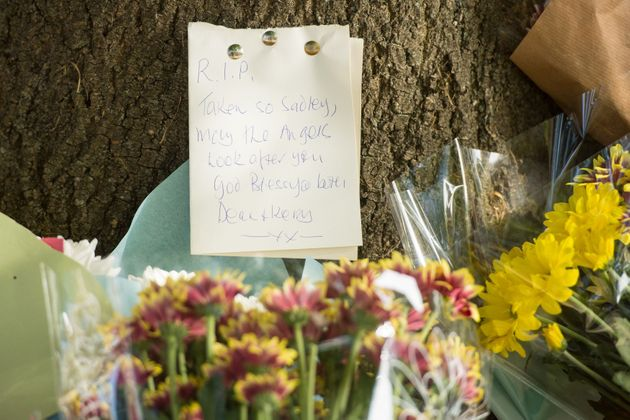 Floral tributes are left on Lennard Road in