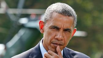 U.S. President Barack Obama pauses as he speaks to the media on the situation in Iraq on the South Lawn of the White House, before his departure for vacation at Martha's Vineyard, in Washington August 9, 2014. Obama said on Saturday U.S. airstrikes have destroyed arms and equipment that Islamic State insurgents could have used to attack Arbil, the Iraqi Kurdish capital, but warned the current operation in Iraq could take some time. REUTERS/Yuri Gripas (UNITED STATES - Tags: POLITICS CONFLICT TPX IMAGES OF THE DAY PROFILE)