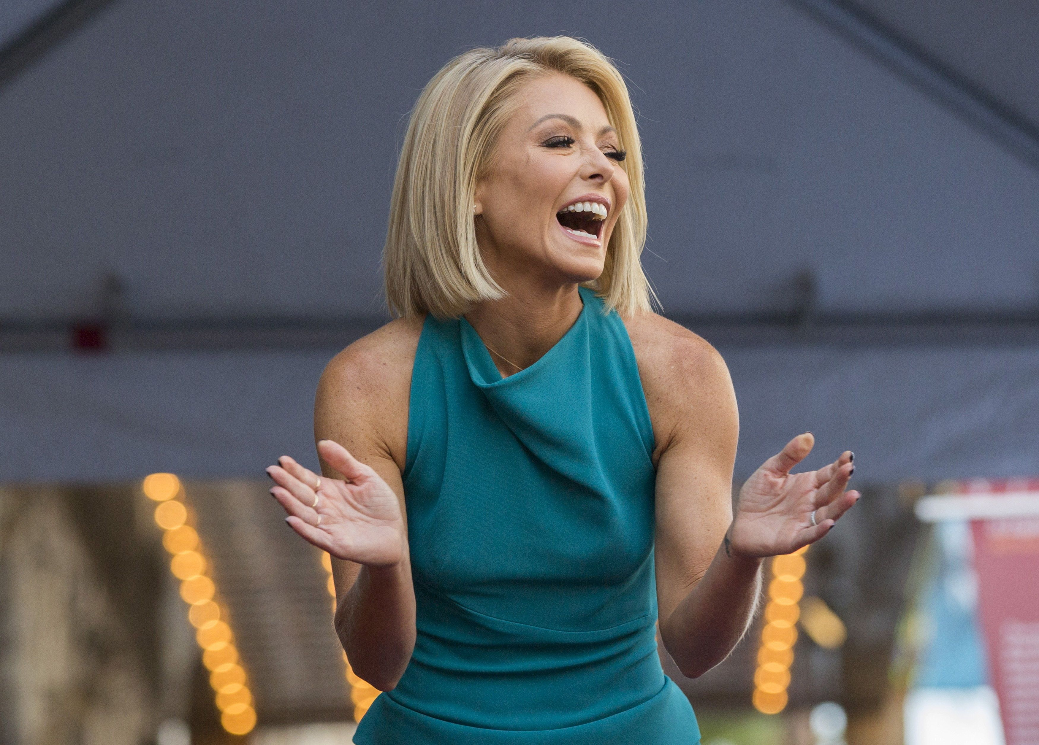 Television personality Kelly Ripa laughs before unveiling her star on the Hollywood Walk of Fame in Los Angeles, California October 12, 2015.  REUTERS/Mario Anzuoni