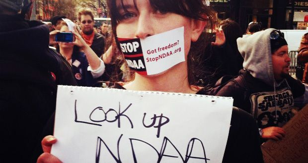 """<i>A protester questions the NDAA's place in American law(<a href=""""http://countercurrentnews.com/2015/11/heres-wh"""