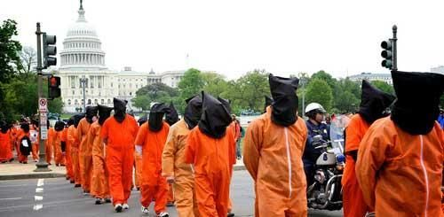 "<i>A 2013 protest of the NDAA and detention of prisoners in Guantanamo, led by Amnesty International (</i><a href=""http://blo"