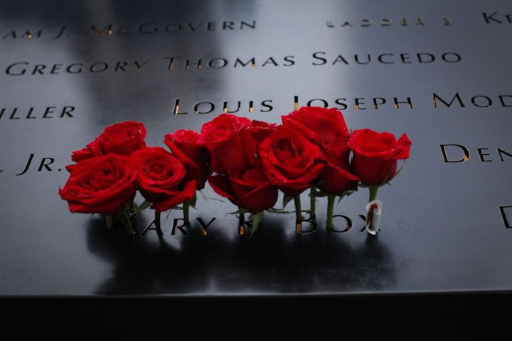 Roses are seen placed on the 9/11 memorial.