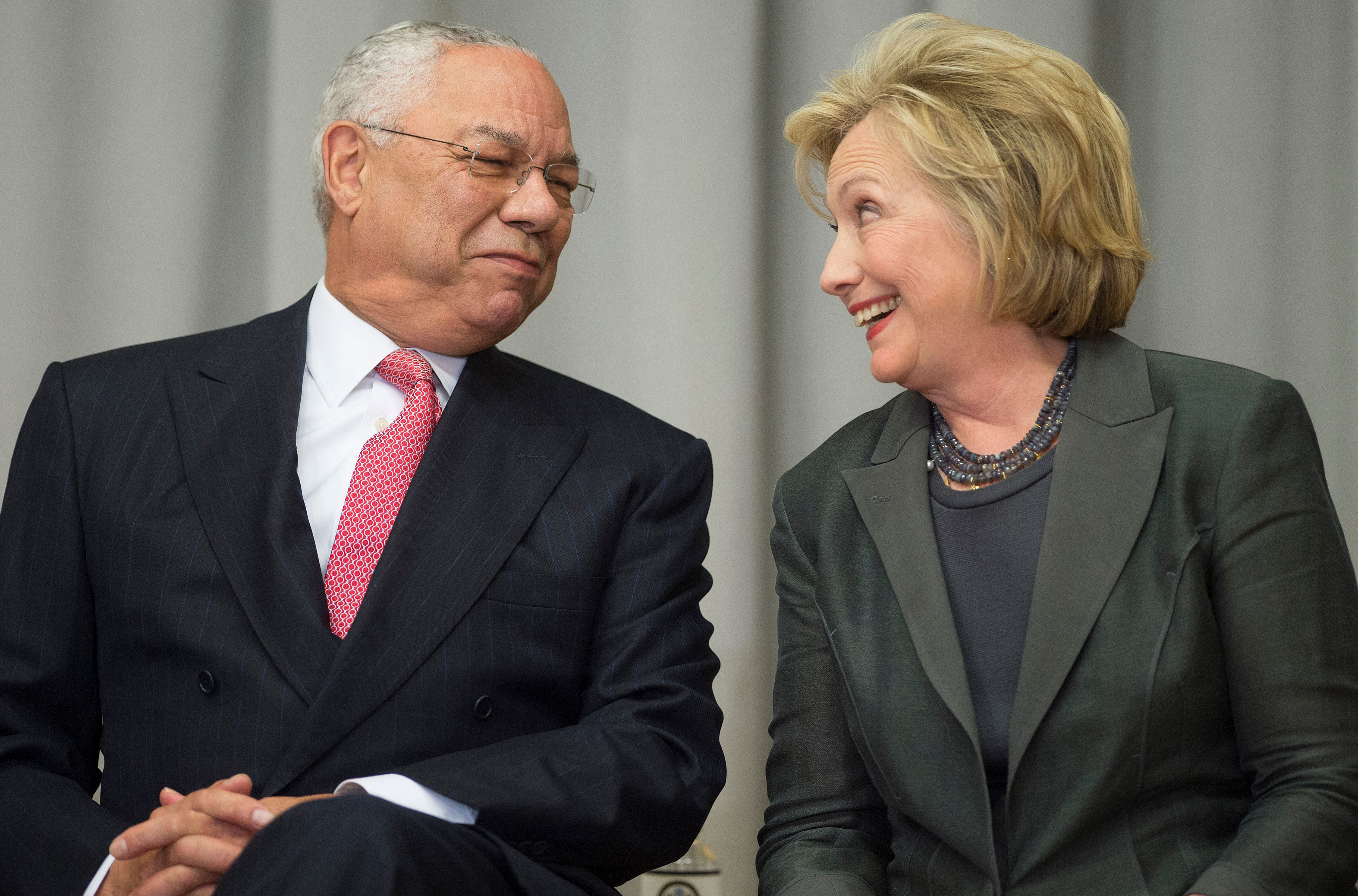 Former US Secretaries of State Colin Powell (L) and Hillary Clinton  speak during a ceremony to break ground on the US Diplomacy Center at the US State Department in Washington, DC, September 3, 2014.                  AFP PHOTO / Jim WATSON / AFP / JIM WATSON        (Photo credit should read JIM WATSON/AFP/Getty Images)
