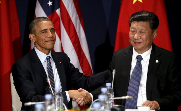 U.S. President Barack Obama shakes hands with Chinese President Xi Jinping during their meeting at the start of the climate s