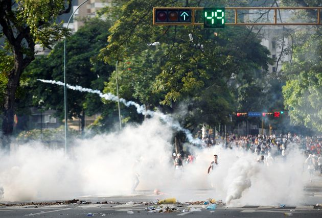 Protesters clash with the police during a rally to demand for a referendum to remove Venezuela's President...