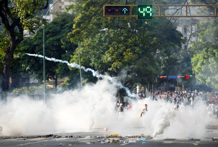 Protesters clash with the police during a rally to demand for a referendum to remove Venezuela's President Nicolas Maduro in