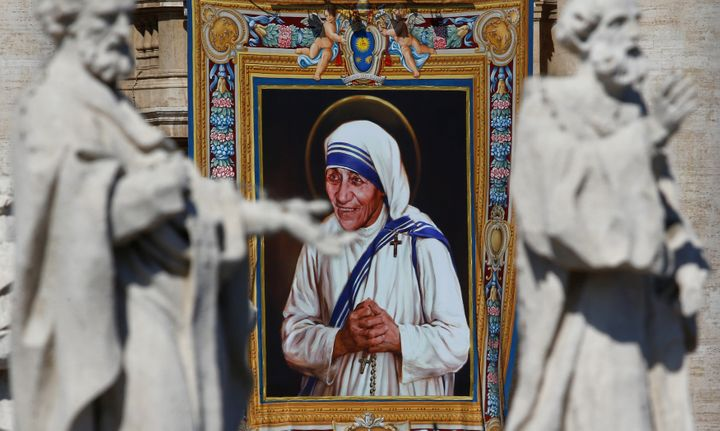 A tapestry depicting Mother Teresa of Calcutta is seen in the facade of Saint Peter's Basilica during a mass, celebrated by P