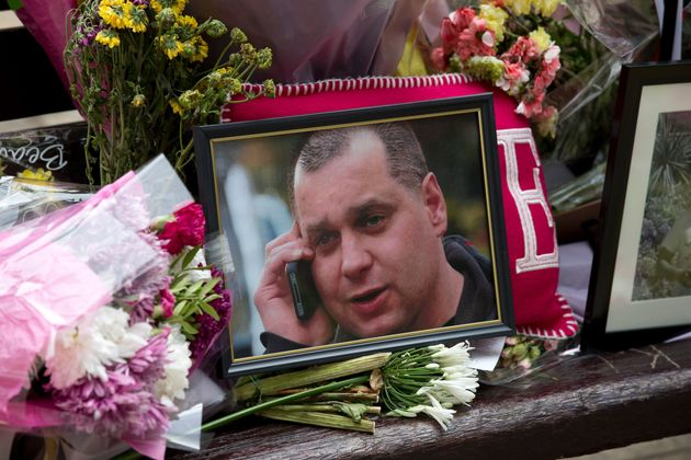Floral tributes and a photograph of Arek Jozwik were placed on a bench at the scene where hewas