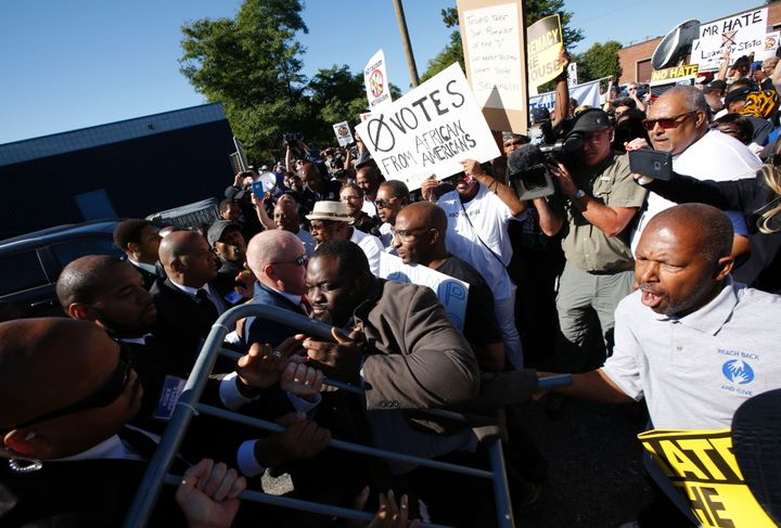 Protesters try to enter the property of Great Faith Ministries in Detroit before a visit by Republican presidential nominee&n