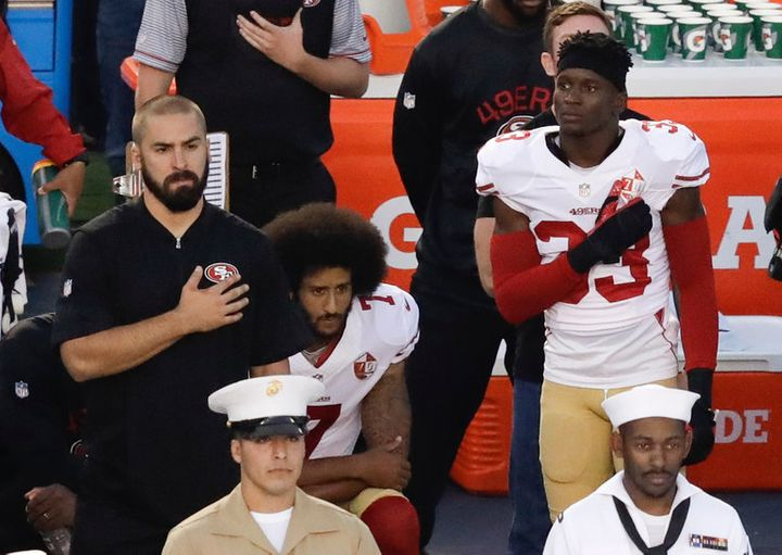Quarterback Colin Kaepernick of the San Francisco 49ers taking a stand by taking a knee during national anthem.