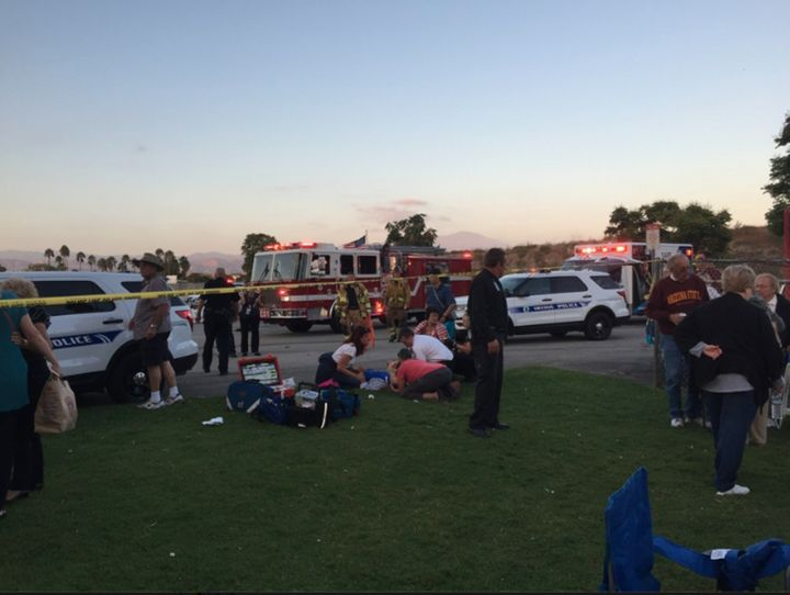 Emergency workers respond to the scene outside the Irvine Meadows Amphitheatre.