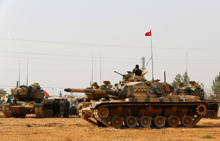 Turkish army tanks and military are stationed in Karkamis on the Turkish-Syrian border in the southeastern Gaziantep province