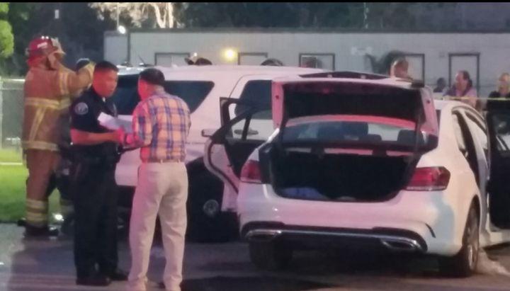 Police investigate the scene of a crash outside Irvine Meadows Amphitheatre.
