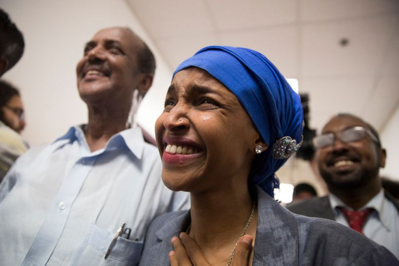 Ilhan Omar walks down the hall ecstatic about her victory over Phyllis Kahn and Mohamud Noor to the watch party for her campa