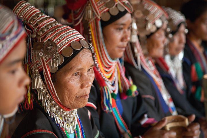 Akha women performing a traditional Akha dance; northern Thailand near Chiang Rai.