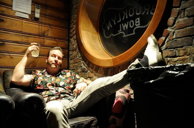 Reel Big Fish singer and guitar player Aaron Barrett makes himself at home in the Brooklyn Bowl green room on February 2.