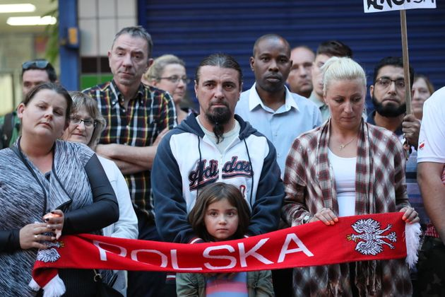 People attend a vigil in Harlow to pay tribute to Arkadiusz