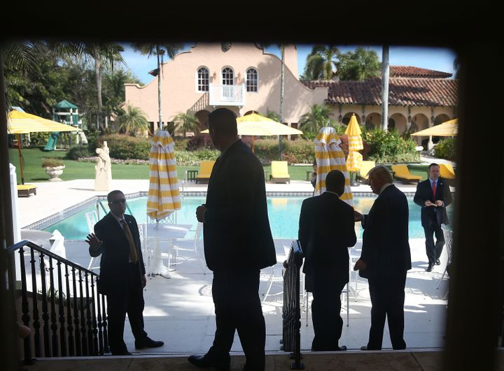 Donald Trump chats with Ben Carson at theMar-a-Lago Club in March. The GOP nominee has spent his campaign's money on hi