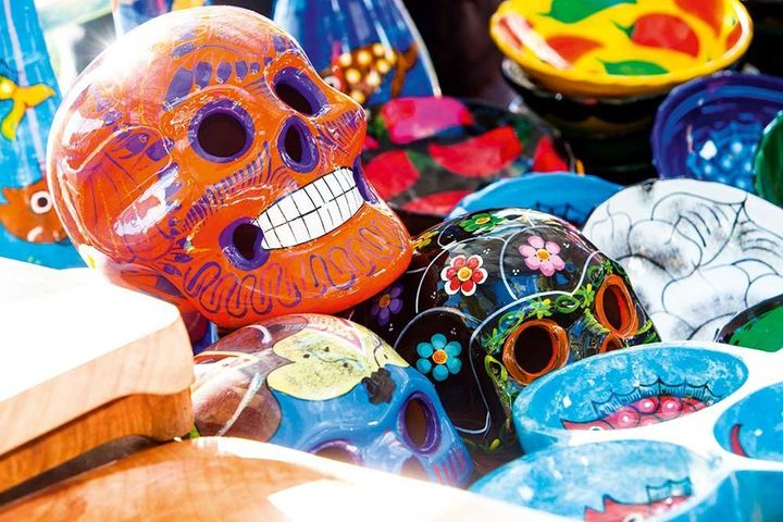 Beautifully hand-painted skulls are offered to souls during Mexican Dia de los Muertos (Day of the Dead) celebrations.