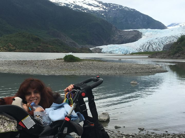 The author's wife and son with carseat/stroller combo, kit and diaper bag, and assorted equipment at the Mendenhall Glacier near Juneau, Alaska. May 2016.