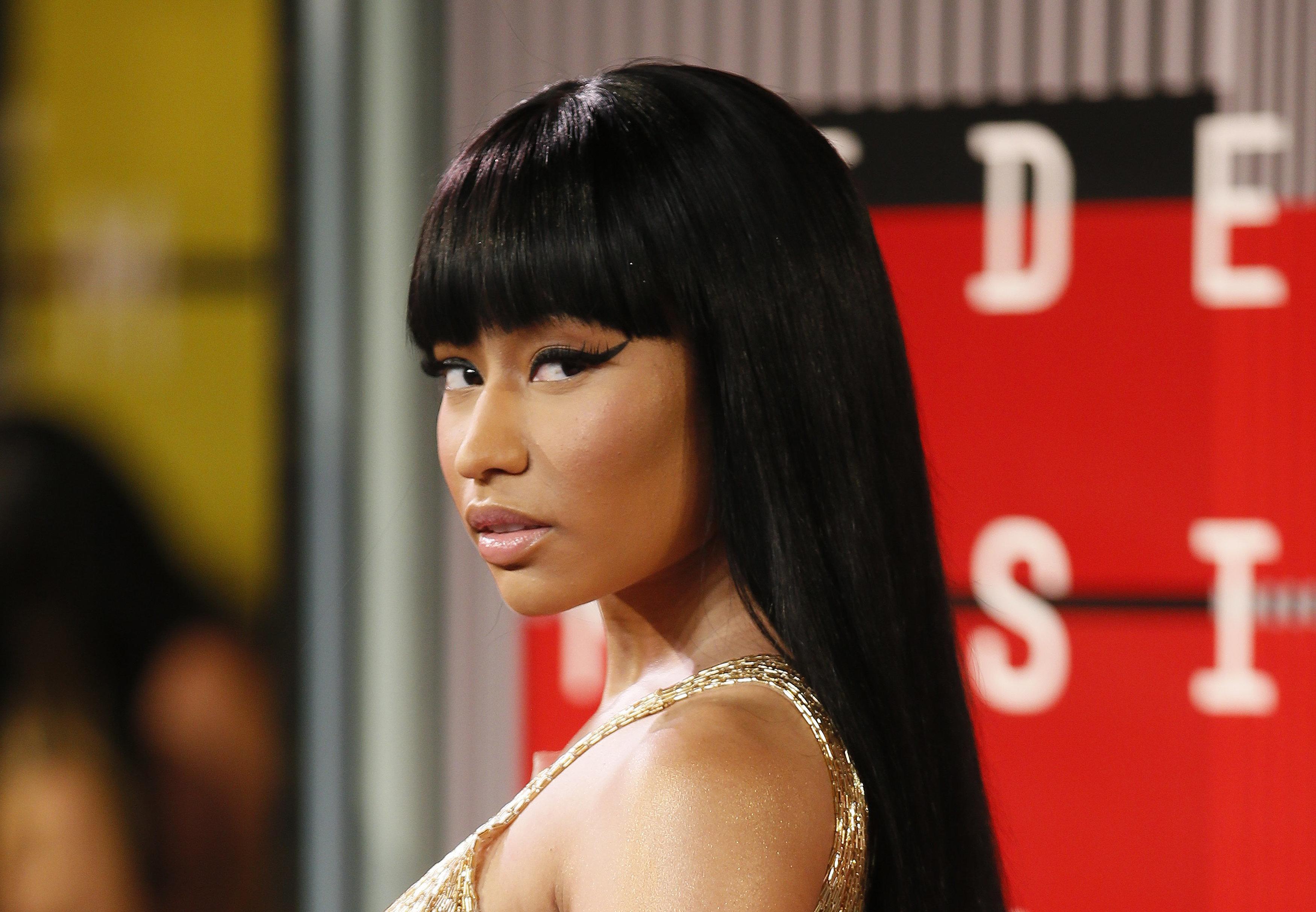 Recording artist Nicki Minaj arrives at the 2015 MTV Video Music Awards in Los Angeles, California, August 30, 2015.  REUTERS/Danny Moloshok