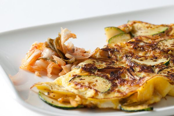 """<strong>Get the <a href=""""http://www.steamykitchen.com/19118-kimchi-omelet-recipe.html"""" target=""""_blank"""">Kimchi Omelet recipe</"""