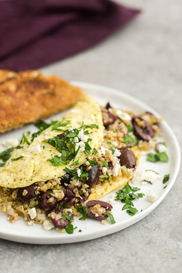 "<strong>Get the <a href=""http://naturallyella.com/freekeh-omelette-with-olives/"" target=""_blank"">Freekeh Omelet with Olives a"