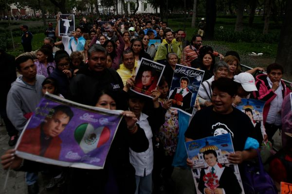 People lineup outside the Palacio de Bellas Artes during the Memorial of Mexican singer Juan Gabriel.
